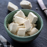 fresh homemade paneer placed in a blue color bowl