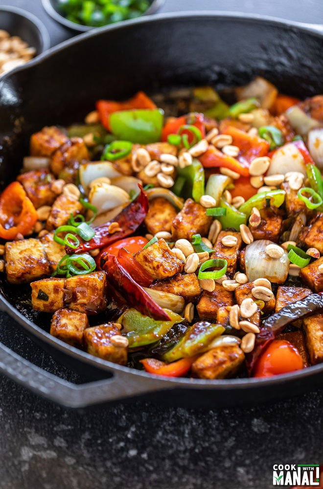 kung pao tofu served in a cast iron skillet