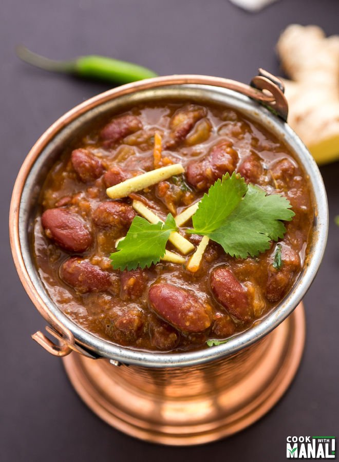 rajma served in a copper balti and garnished with cilantro