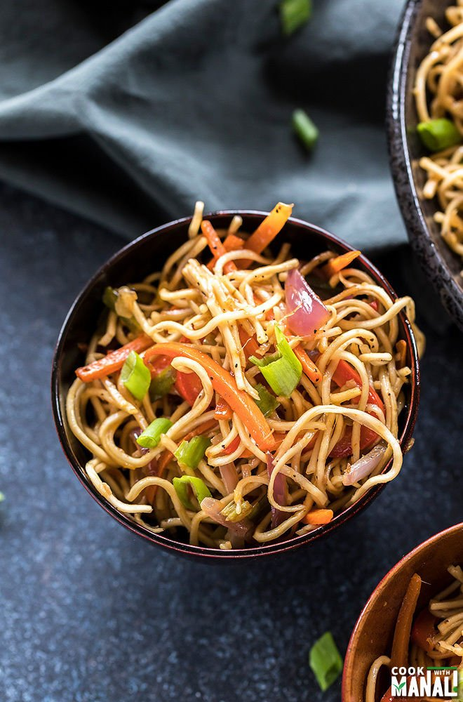 vegetarian hakka noodles in a small wooden bowl