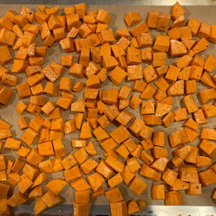 diced sweet potatoes placed on a baking tray