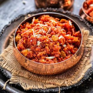 gajar halwa served in a copper bowl
