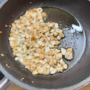 fried cashews in a pan