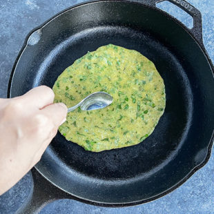 oil being applied to a paratha