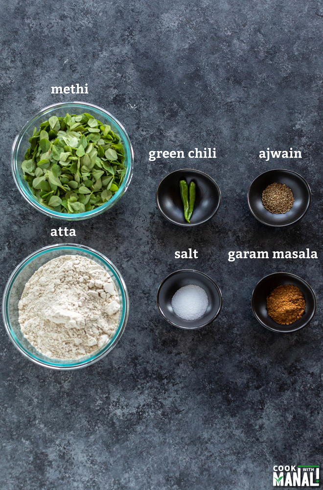 6 bowls filled with different ingredients like spices, flour, salt