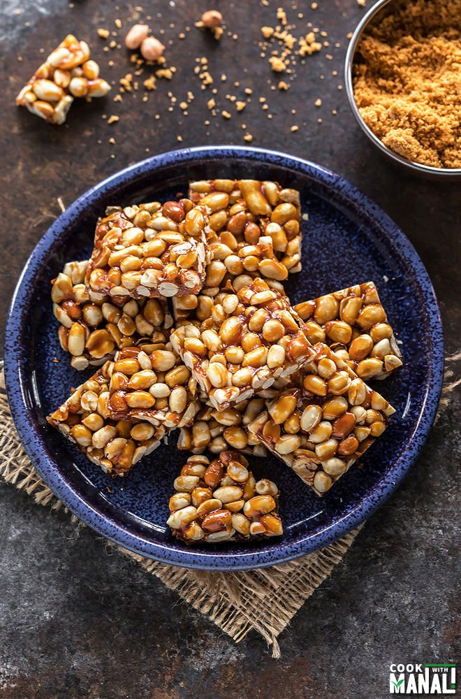 peanut chikki in a round blue plate
