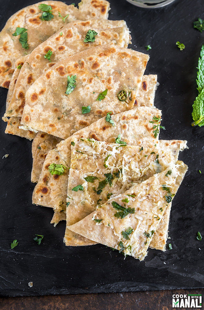 over head shot of mooli paratha which has been cut into small triangles