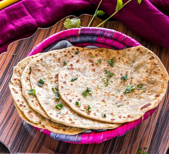 mooli paratha arranged in a pink basket