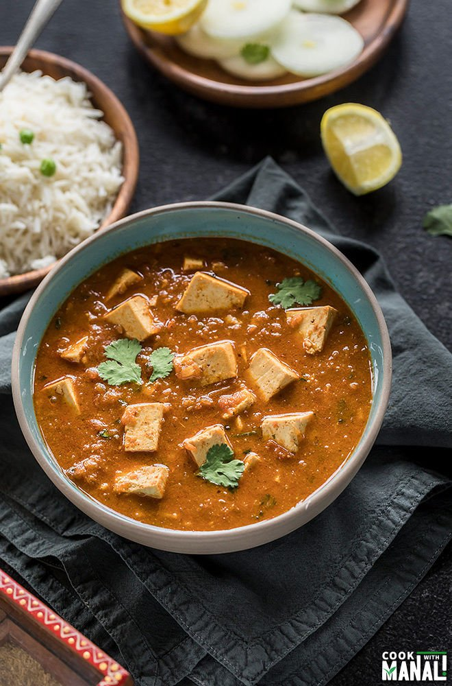 tofu tikka masala served in a blue bowl and garnished with cilantro