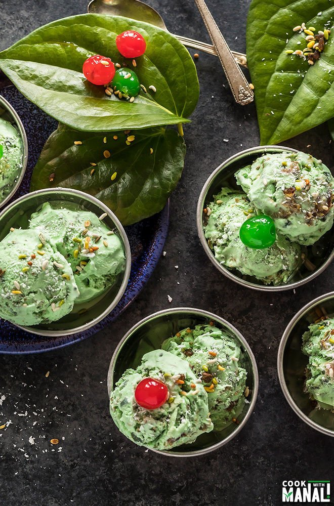 overhead shot of paan ice cream served in small copper bowls and garnished with coconut and cherries