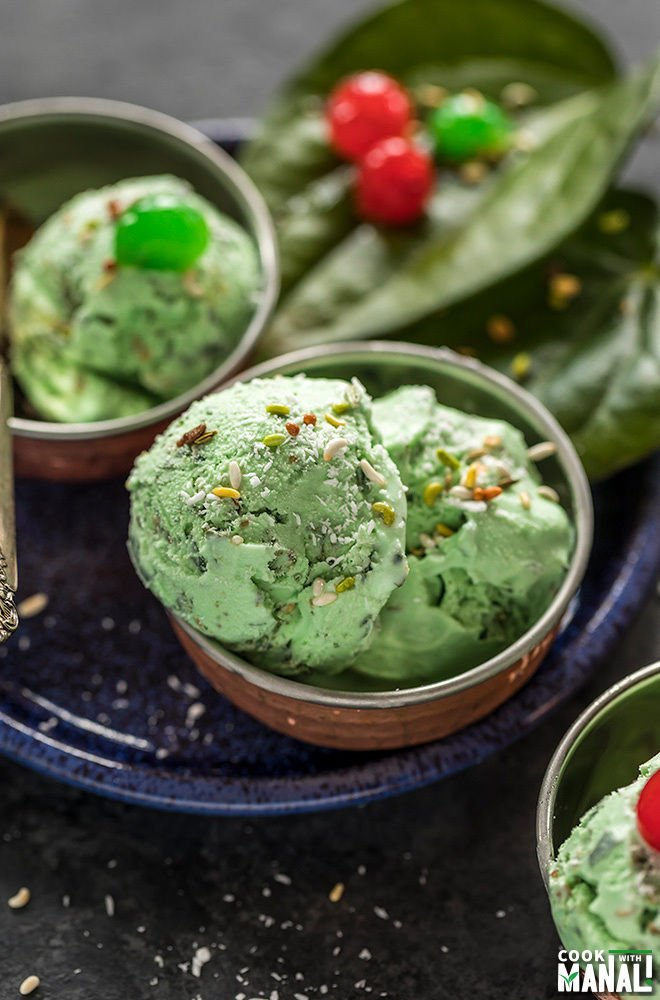 paan ice cream in small copper bowls and garnished with coconut and cherries