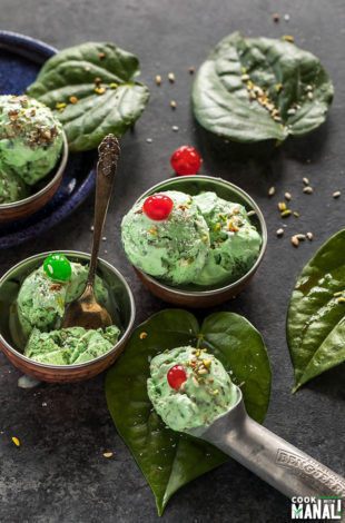 paan ice cream served in small copper bowls and garnished with coconut and cherries