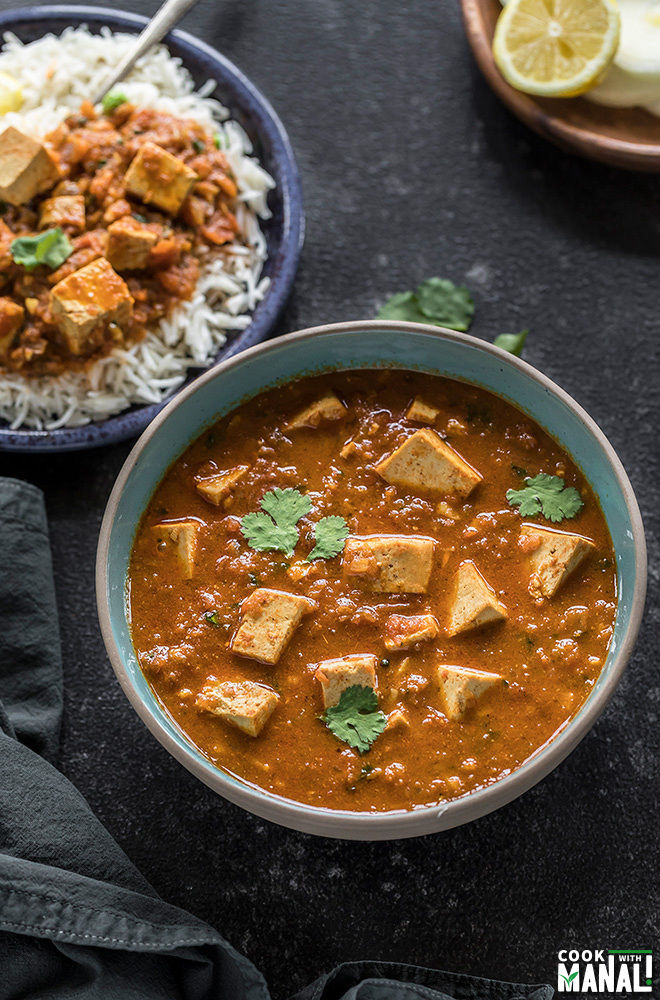 instant pot tofu tikka masala served in a blue bowl and garnished with cilantro