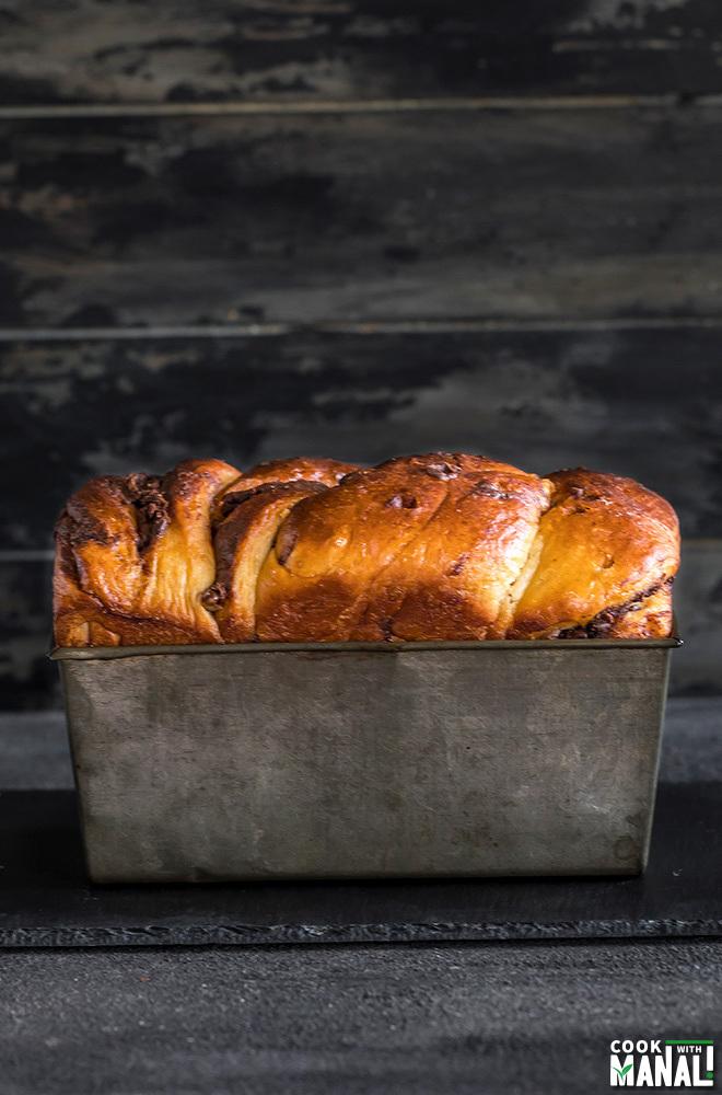 loaf of nutella babka in an antique loaf pan