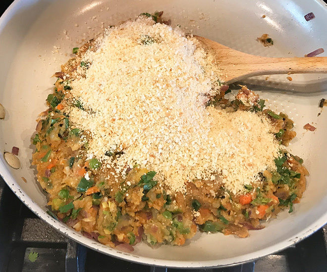 mixed veggies with bread crumbs in a pan