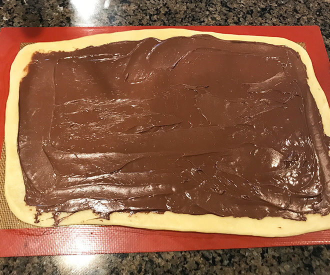 babka dough rolled into a rectangle and filled with nutella