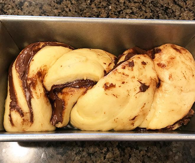 babka dough in a baking pan