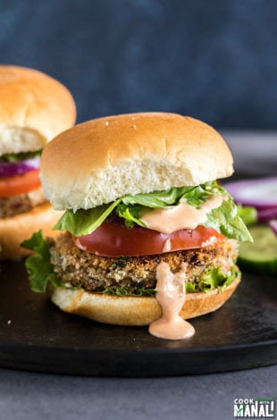 vegetarian burger with lettuce, tomato and a dripping burger sauce