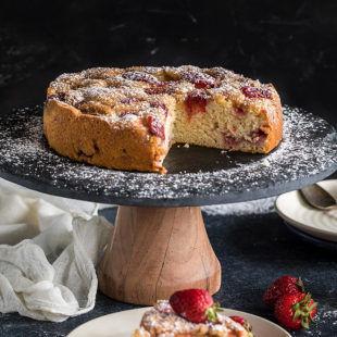 sliced strawberry cake on a black cake stand