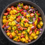 strawberry mango salsa in a large grey bowl
