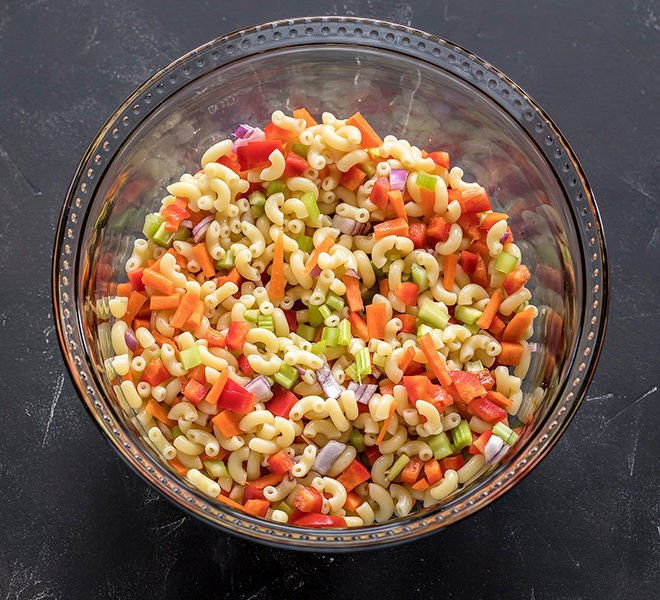 a bowl with boiled macaroni and chopped veggies