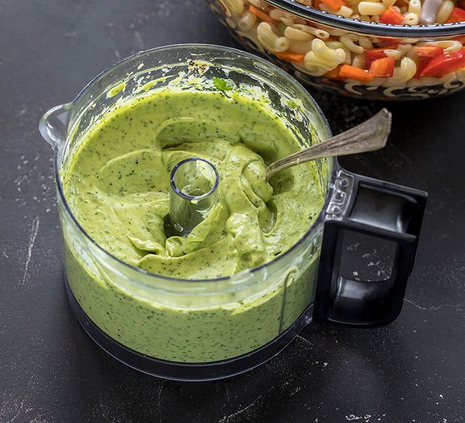 creamy green avocado dressing in a small food processor