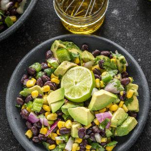 black bean corn salad in a black bowl