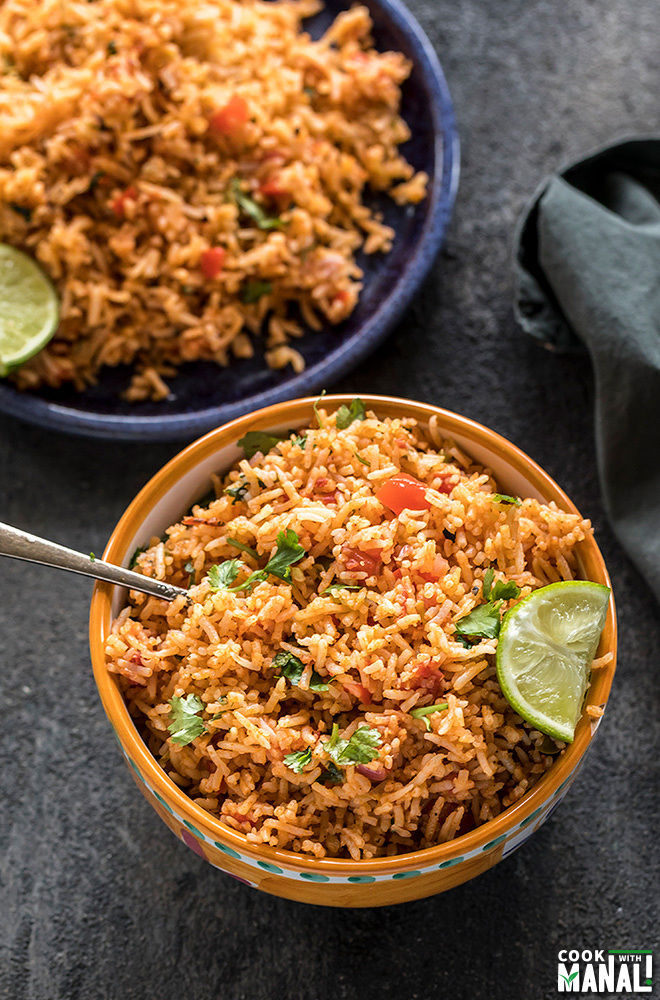 instant pot mexican rice served in a yellow bowl with lime wedge on the side