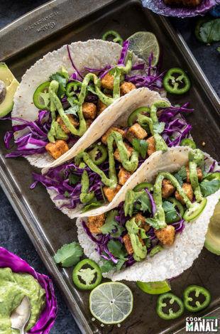3 crispy tofu tacos topped with avocado lime crema