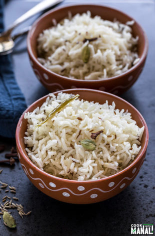 instant pot jeera rice served in a clay bowl