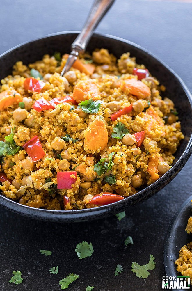 sweet potato chickpea quinoa in a black bowl