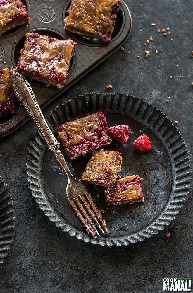vegan peanut butter & jelly bars with a fork