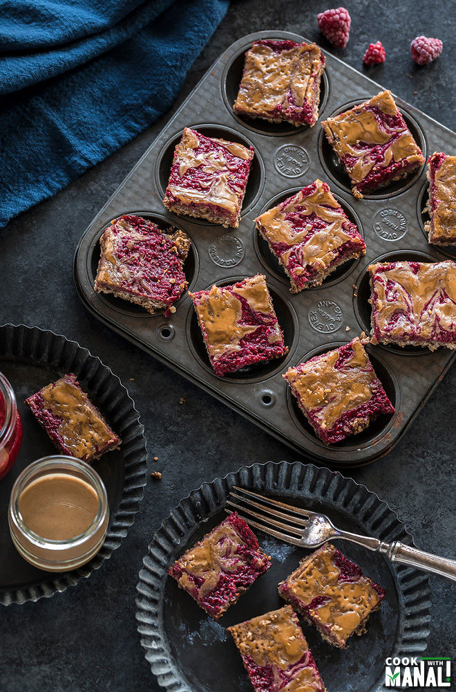 vegan peanut butter & jelly bars placed in a muffin tin