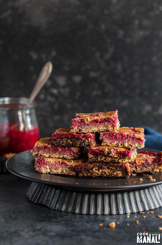 vegan peanut butter & jelly bars on a black plate