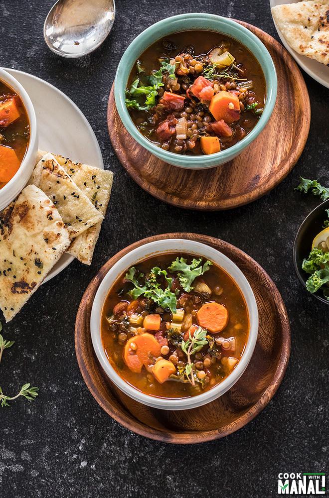 overhead shot of 3 bowls of vegan lentil soup