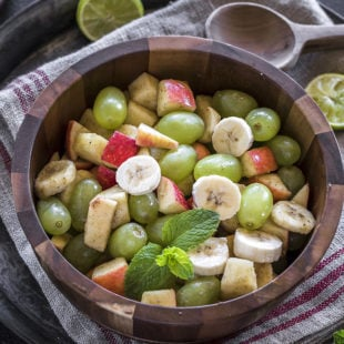 Indian fruit chaat in a wooden bowl
