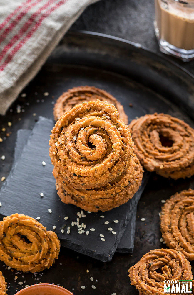 stack of homemade chakli on a black plate