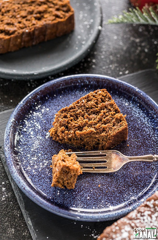 slice of vegan gingerbread cake being cut with a fork