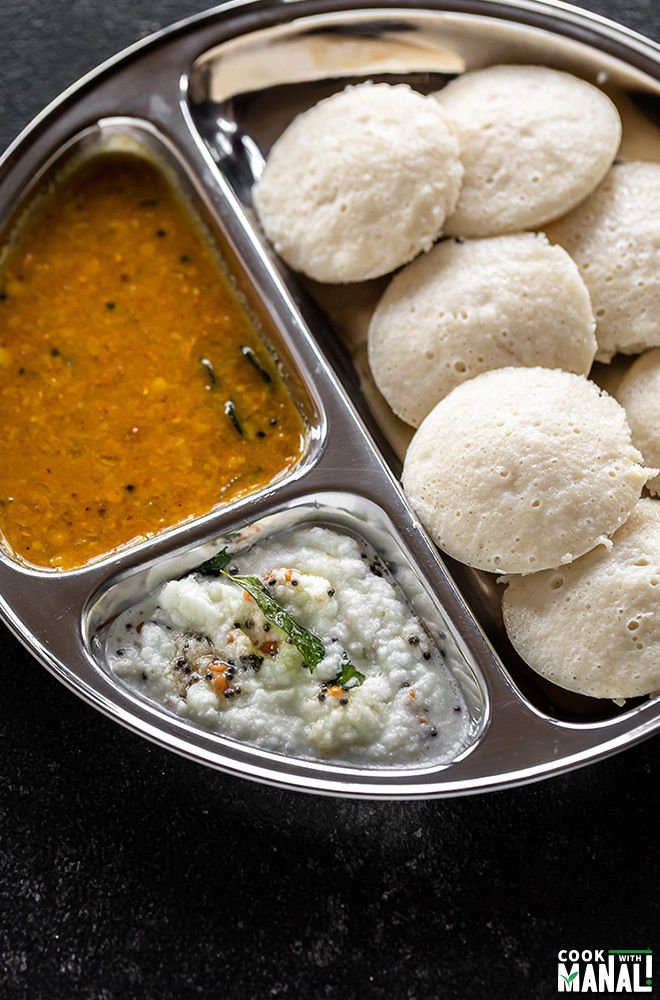 plate of idli with sambar and coconut chutney
