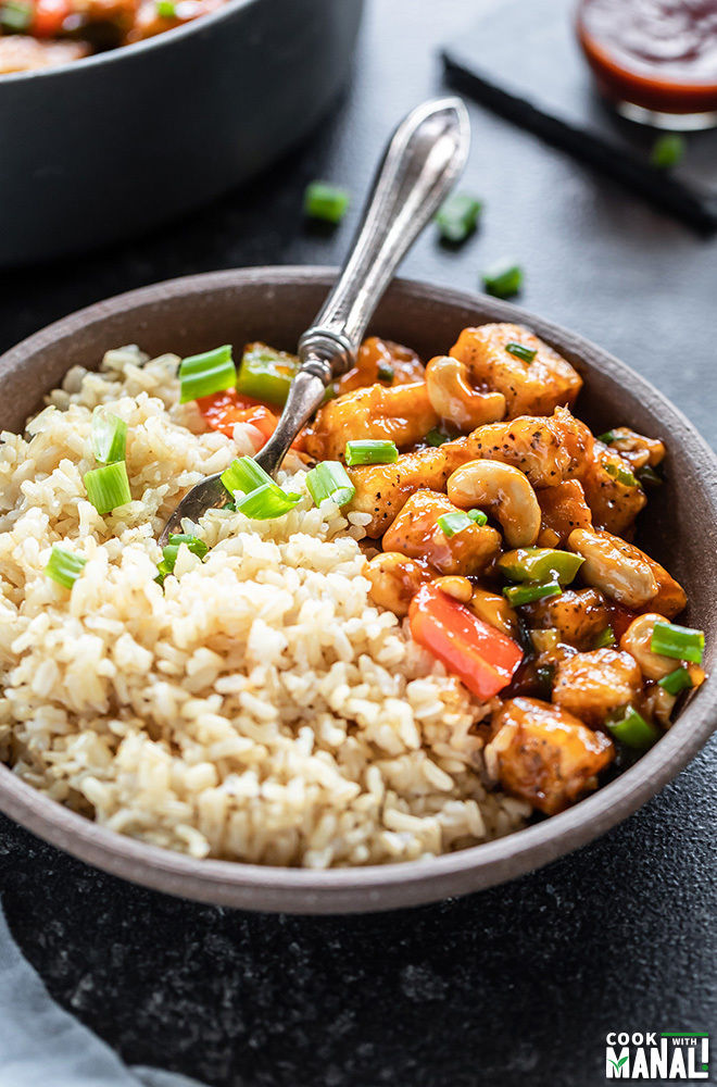 bowl of honey cashew tofu with brown rice