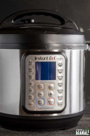 instant pot against a black background