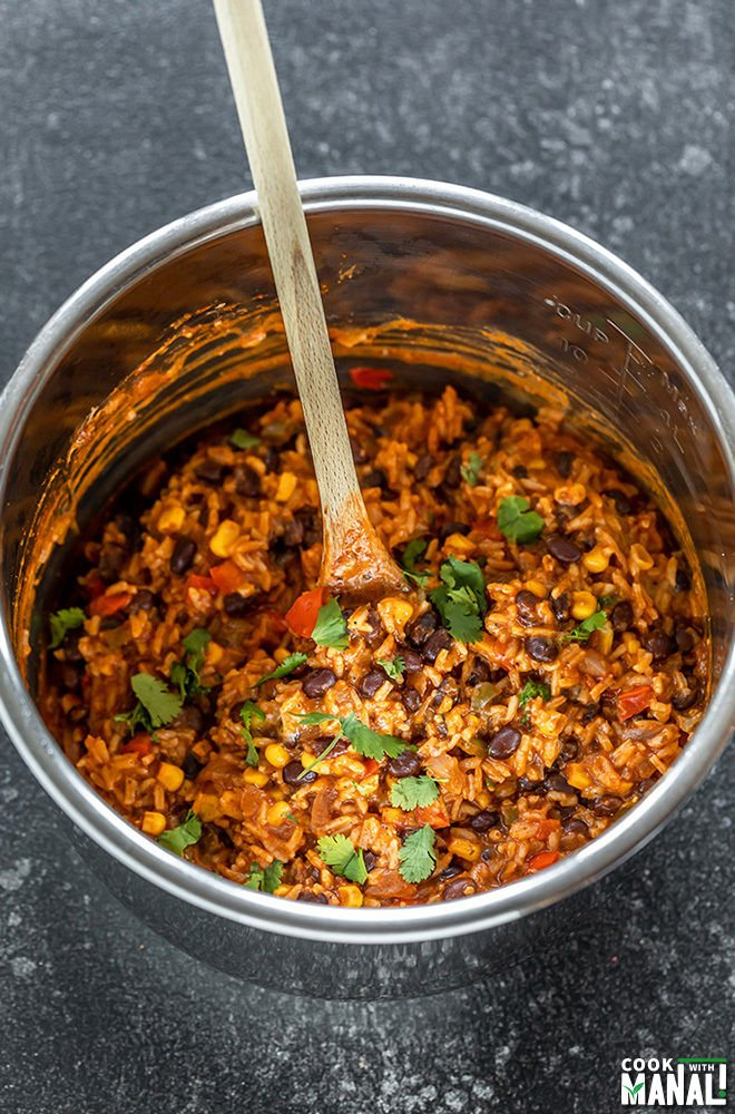 enchilada rice in an instant pot with a spatula