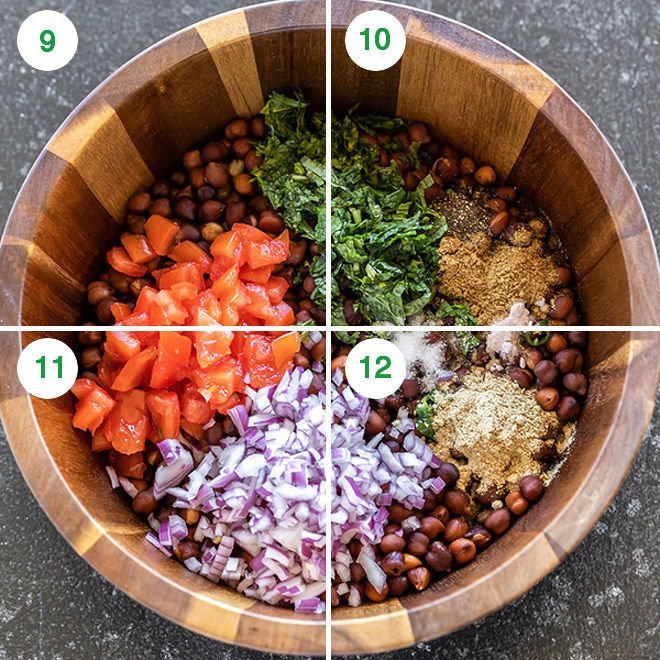 black chickpeas with chopped onion, tomato, cilantro and spices in a wooden bowl