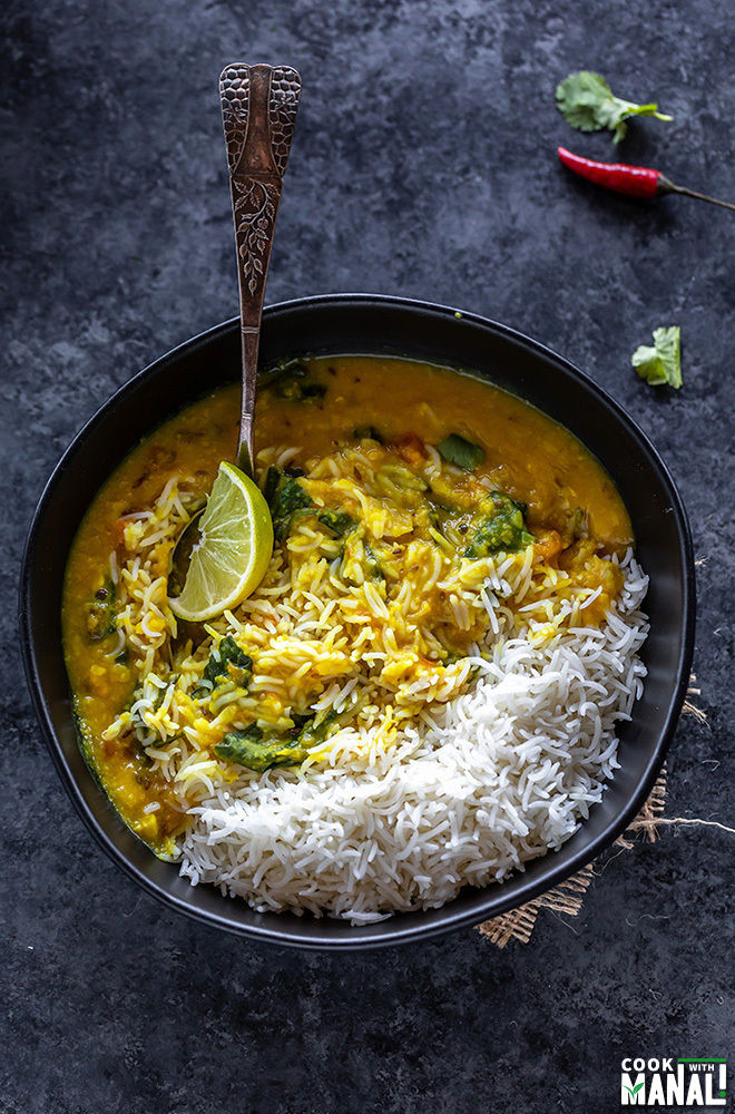 rice and dal in a bowl with a lemon wedge