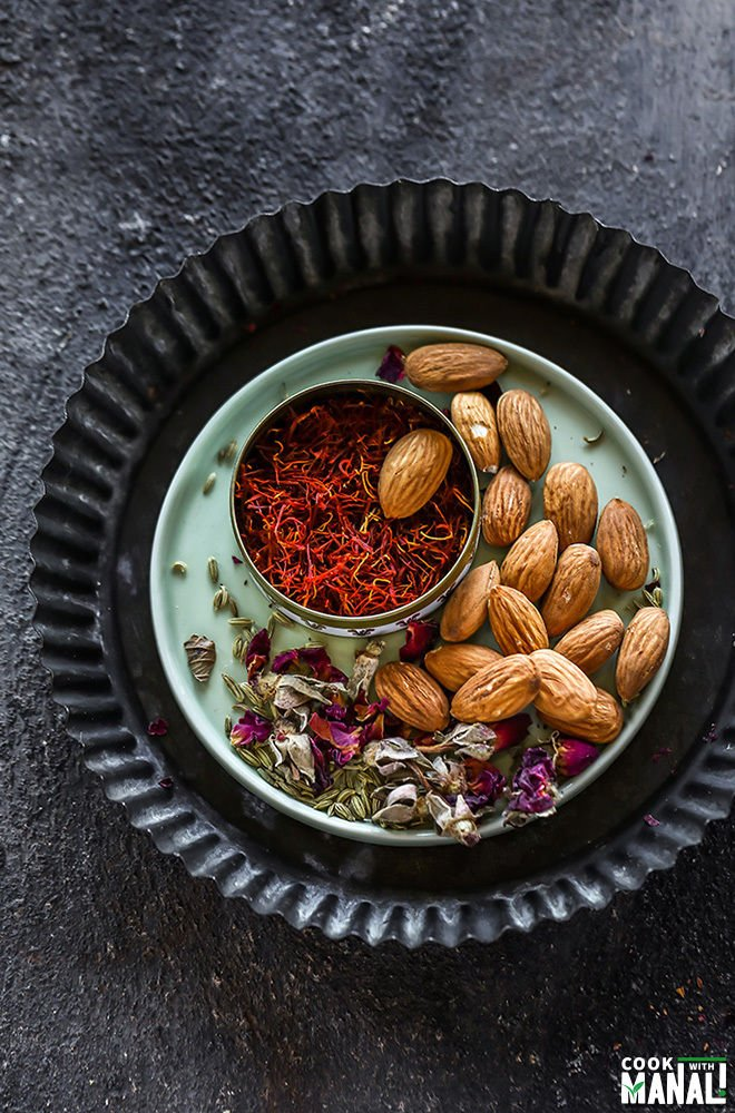 a small plate with almonds, saffron and dried rose petals