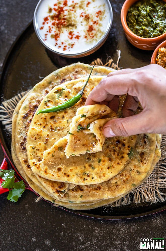 taking a bite from paneer paratha