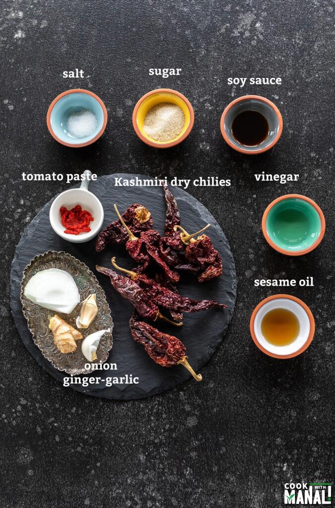 ingredients for schezwan sauce arranged on a board