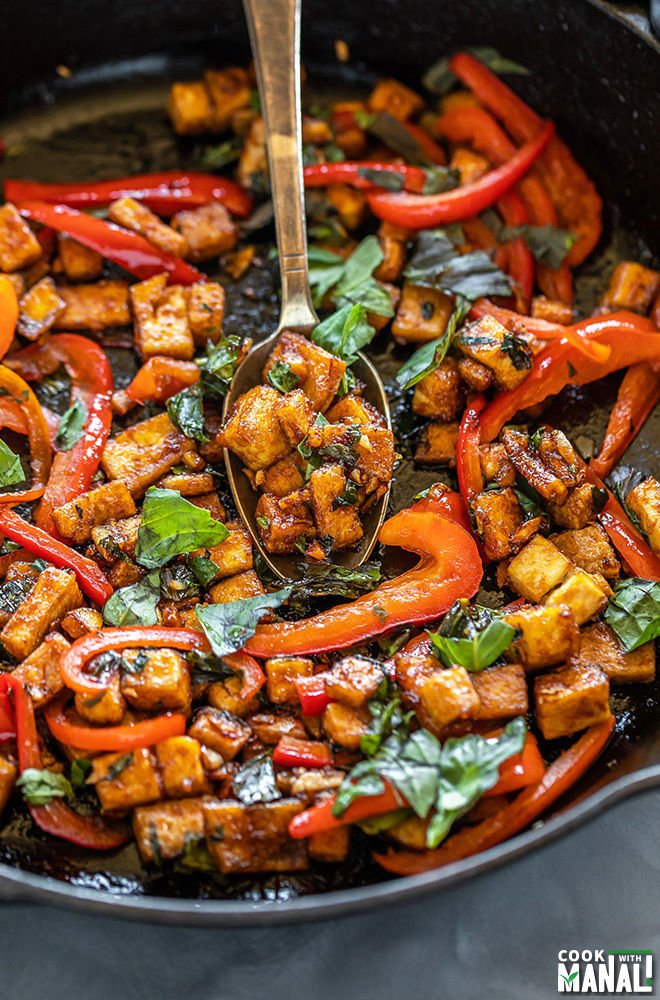 cast iron pan with basil tofu stir fry