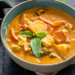 vegan panang curry served in a bowl and garnished with basil