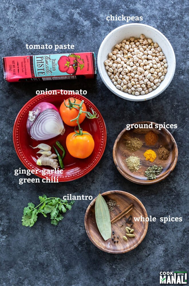 ingredients to make chana masala arranged on a board